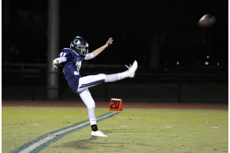 ODA senior Bryan Kirshe punts the ball late in the first half.