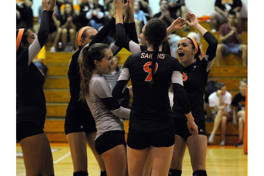 The Sarasota High volleyball team celebrates a point during its 3-1 Class 7A-District 10 semifinal victory over Braden River Oct. 22.