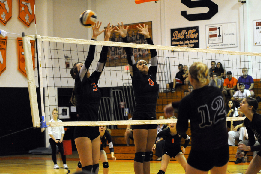 CeCe Knight and Desiree Leiding go up for a block in the second set.