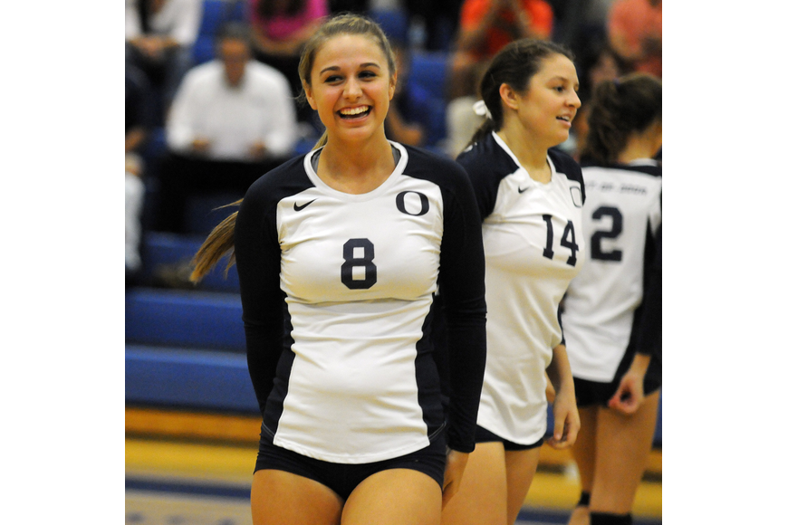 Freshman Olivia Kuebler celebrates following the Thunder's go-ahead point in the fourth set.