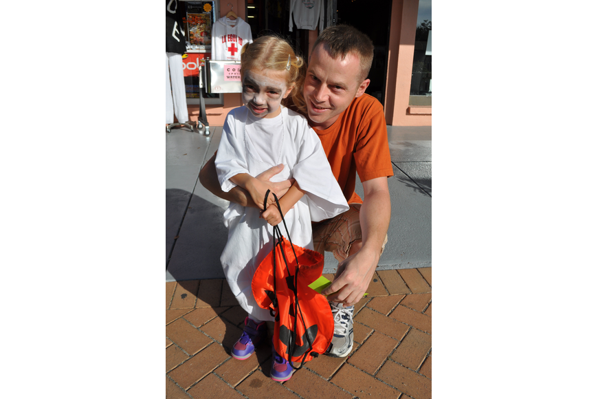 Annabel, 3, and her father Richard Deal enjoy trick-or-treating.