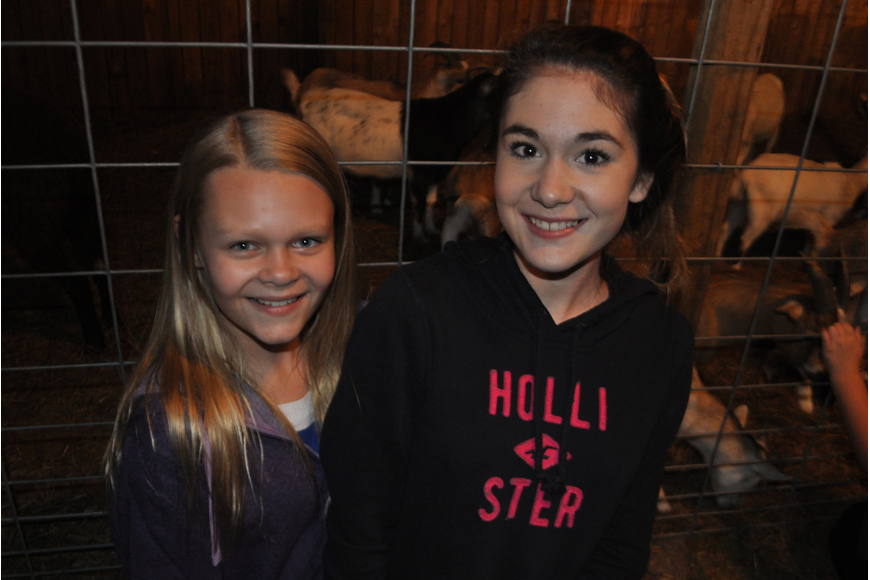 Caroline Kincaid and Mikayla Lemieux stop by the petting zoo.