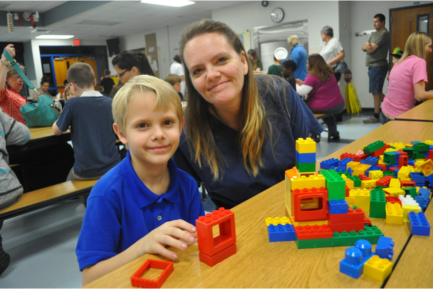 Annette Price and her third-grade son, Terry, built a house to hold cars.