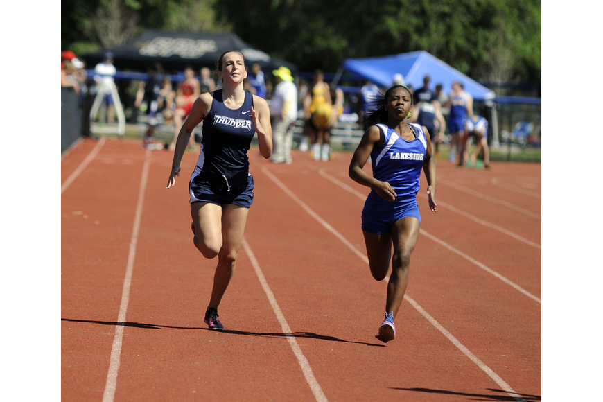 ODA's Emma Young looks to break past a Lakeside Christian runner down the stretch of the 100-meter dash.