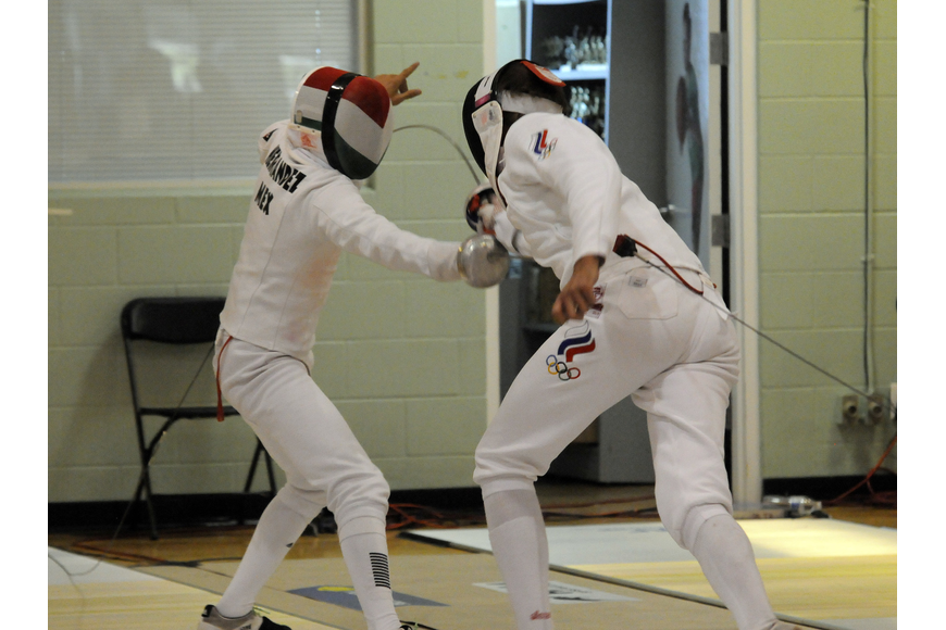 Mexico's Ismael Hernandez Uscanga and Russia's Aleksander Lesun bout during the mixed relay round robin fencing event.