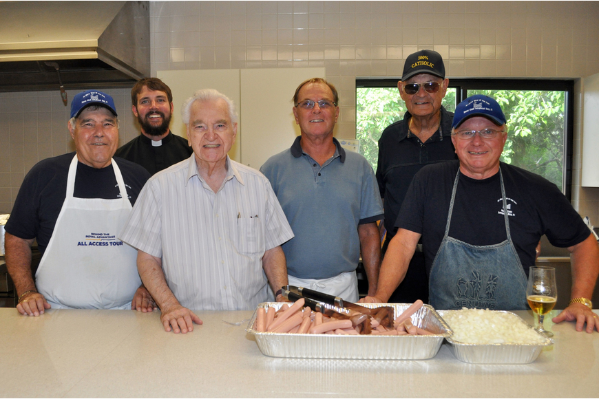 Joe Zanpino, Fr. Eric Scanlan, Frank Cerullo, Jim McGuire, Fr. Edward Pick and St. Mary Star of the Sea's Men's Club president Dave Carter