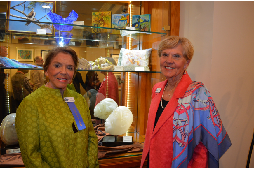 Exhibitor Joan Partridge and Art Committee Chairperson Marilyn Huseby in front of Partridge's alabaster sculpture