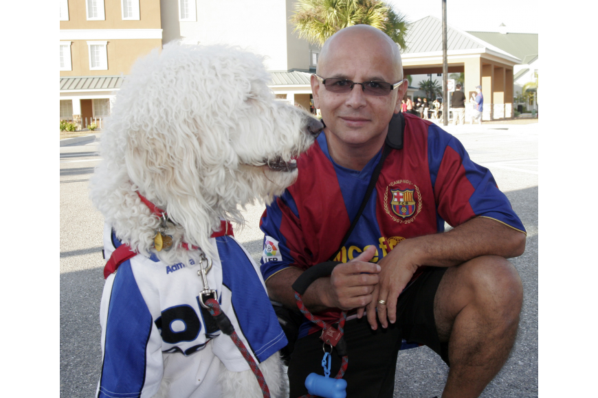 Pedro Hernandez brought his dog, Rocky, to the festival.
