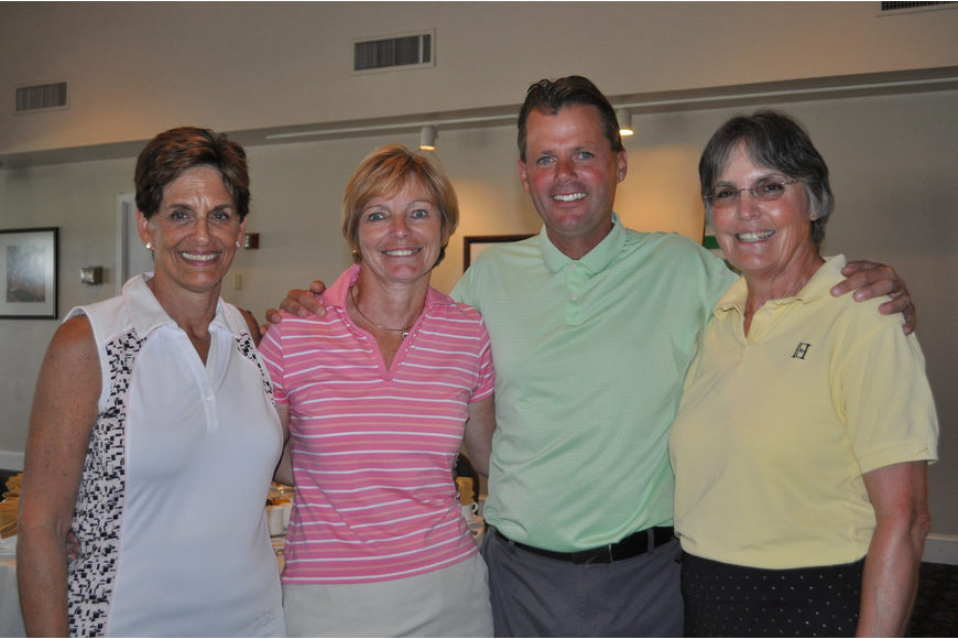 Three players from the winning foursome, Jayne Weiss, Regina Repenning and Carol Meese, with the Director of Golf, Terry O'Hara.