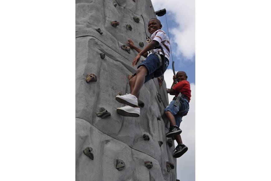 Oqu'zon Bellamy-Bey, 10, climbed alongside his 5-year-old brother Charlie Harris, not pictured.