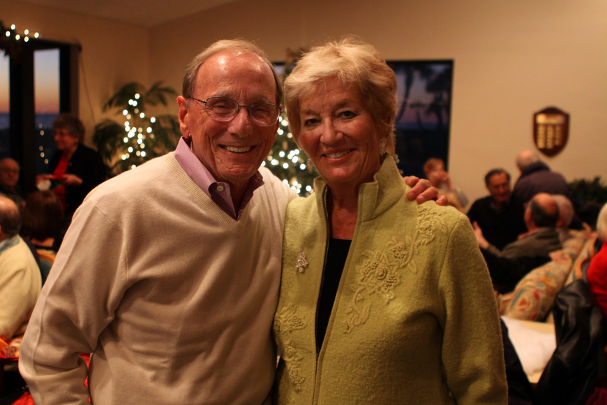 Dick Antonello and Sue Hoeft get together for a photo during Seaplace's Welcome Back Holiday Party, Wednesday, Dec. 15.