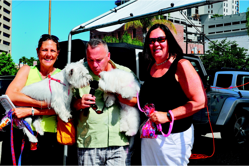 Denise Barbato, Allan Zuckerman and Ann Martin cuddle with Riley and Maddie in May at the Parade of Pups.
