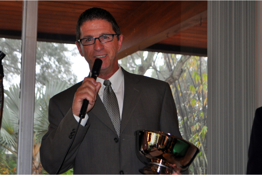 Vice President of property management for One Sarasota Tower, Earl Fossum, accepts the Silver Bowl Award.