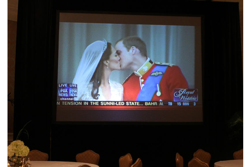 The first kiss between the newly wedded Duke and Duchess of Cambridge Friday, April 29 was shown on two large screens during the royal wedding celebration at the Ritz Carlton.