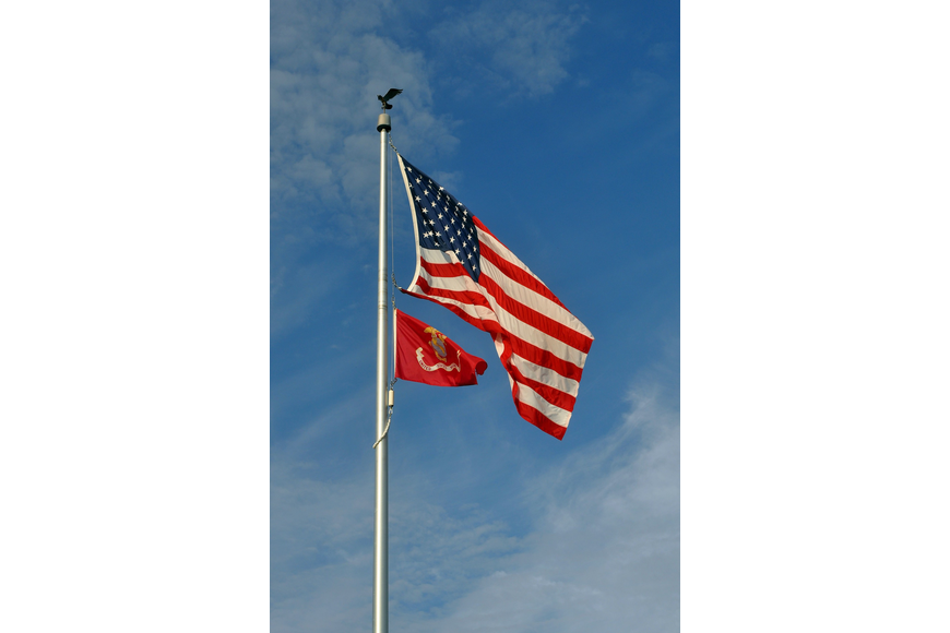 The American flag and the flag for the United States Marine Corps fly high at the Gold Coast Eagle Distributing facility out in Lakewood Ranch.