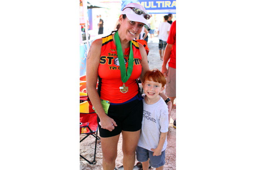 Lisa Brewer poses with her nephew, Cooper Schrock, 5, who ran the last few feet of the triathlon with Brewer.