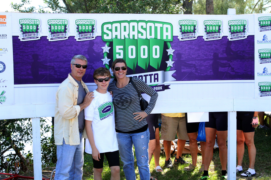 Tom, Hugh and Elaine Jenkins pose for a family photo Sunday, Oct. 2 during the Sarasota 5000 Regatta out at Blackburn Point Park.