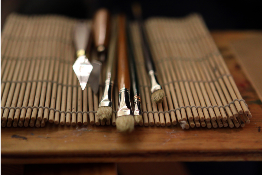David Leffel's paint brushes and tools lay out on his work table during a break in the workshop on Monday, Feb. 21, at Longboat Key Center for the Arts.