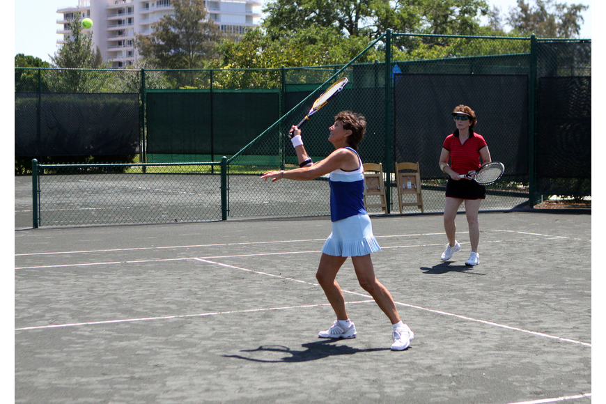 Jeanne Brown goes for the volley during her doubles match Friday, April 22 during the Lunch Bunch All-Star Children's Foundation fundraiser at the Longboat Key Club Tennis Gardens.