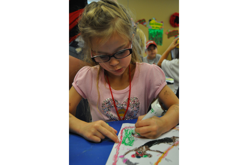Savannah DiDomenico, 5, worked hard on her art project.