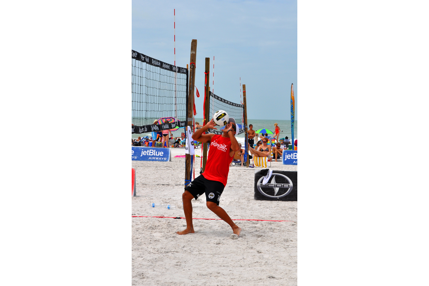 Adrian Carambula gets ready to set the ball for his teammate, Steve Grotowski, during the Siesta Key Gulf Open, Saturday, July 9 at Siesta Key Beach.