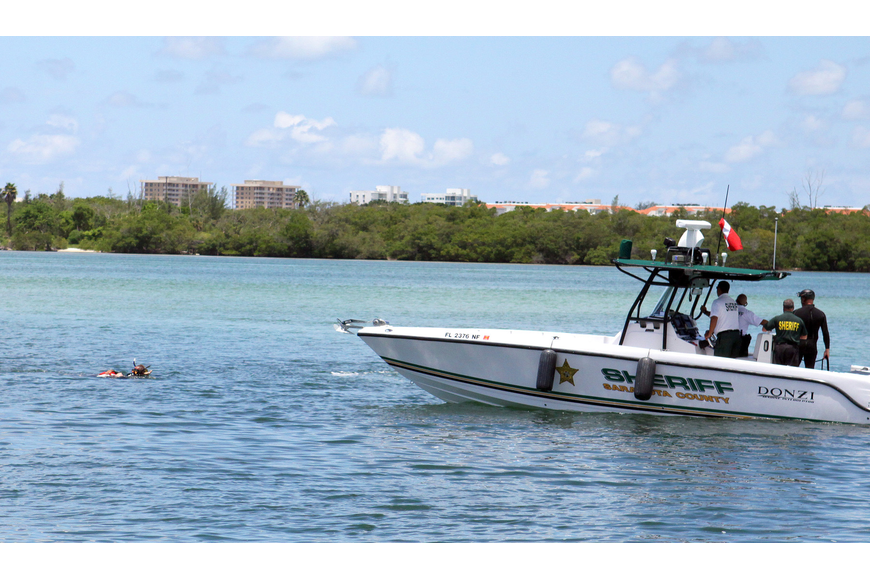 Deputy sheriffs Matt Binkley and Mike Watson make their way with the mannequin to the rescue boat as part of the mock marine search and rescue mission Thursday, July 21 at Ken Thompson Park Boat Ramp.