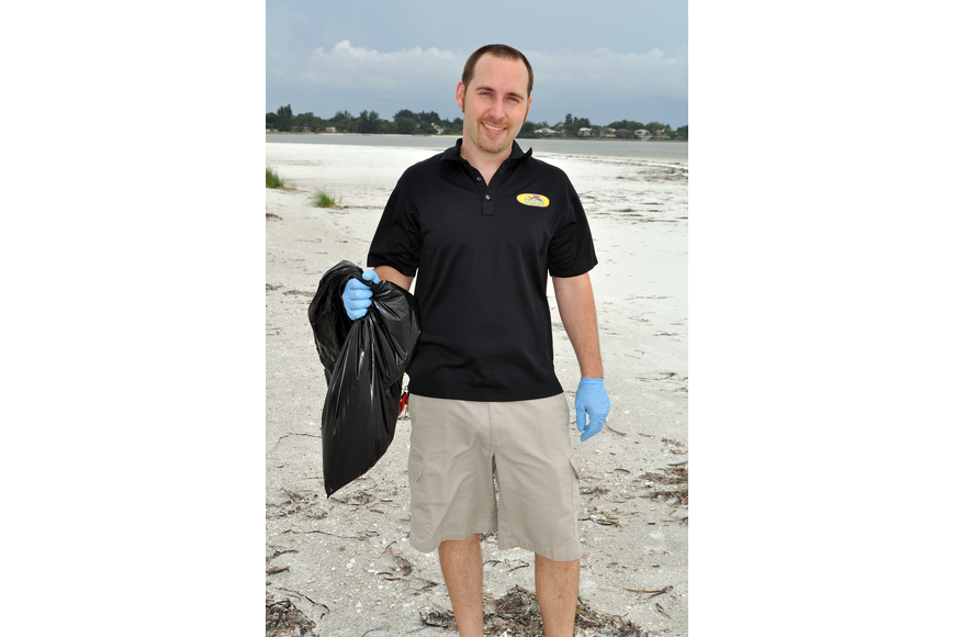 Daiquiri Deck's Peter Aberg came out to clean the beach Thursday, Sept. 8, at Ted Sperling Park.