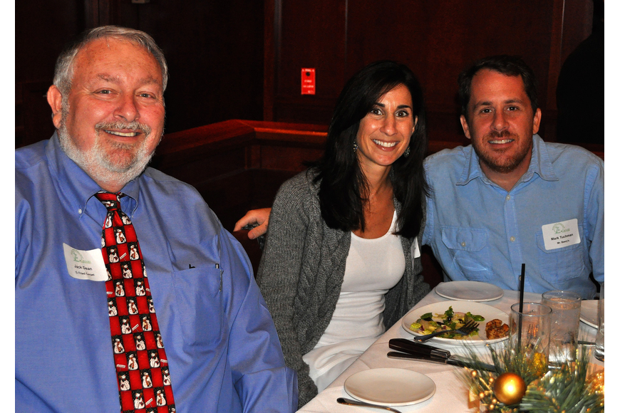 Jack Dean poses with Christine and Mark Tuchman at the Siesta Key Chamber holiday luncheon.
