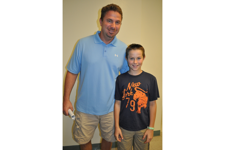 Bill Jula and his son, Peyton, checked out the school.