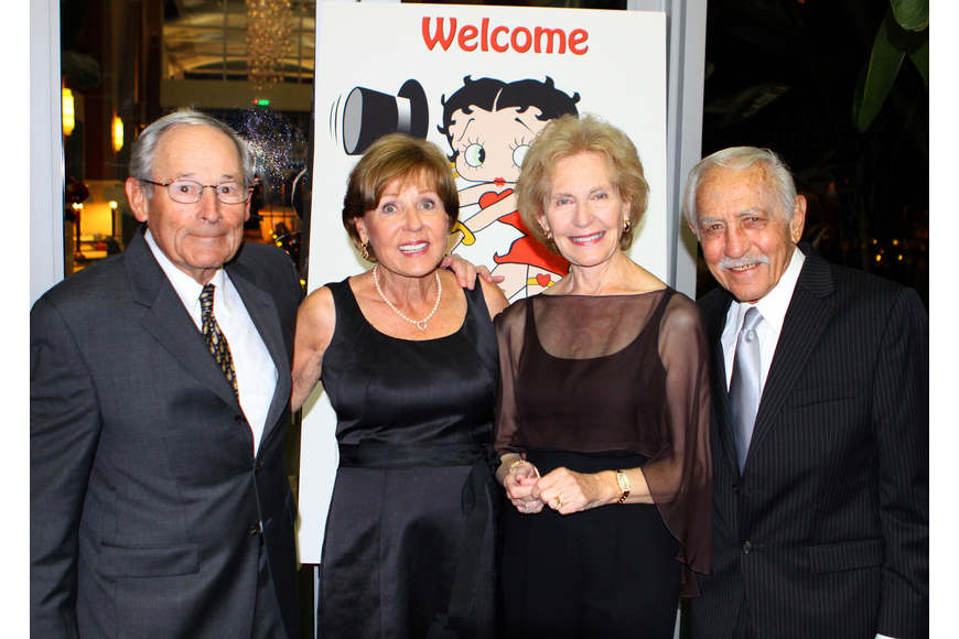 Marty and Marge Heller pose with Elaine and Donald Weill