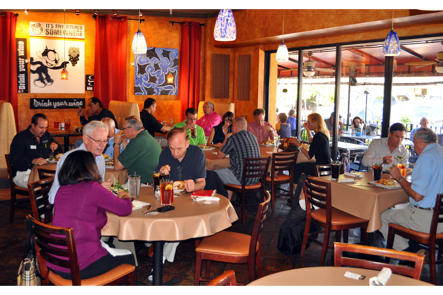 Members of YES enjoy some lunch before having their meeting, Tuesday, March 13, at Clayton's Grille.