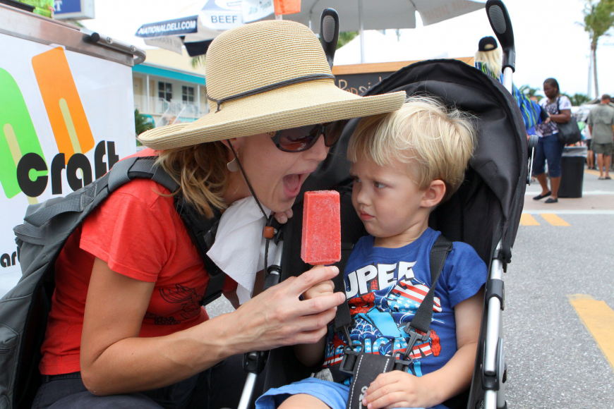 Kate Boyett tries to steal a lick from Asher Boyett's, 3, Pop Craft popsicle, Saturday, April 14, at Siesta Fiesta.