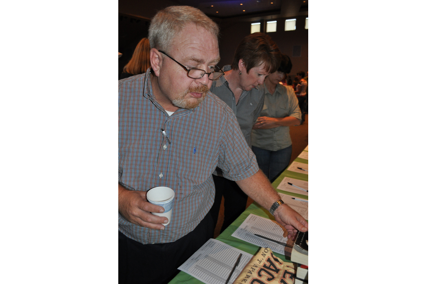 Bill Shevlin checked out the silent auction items.