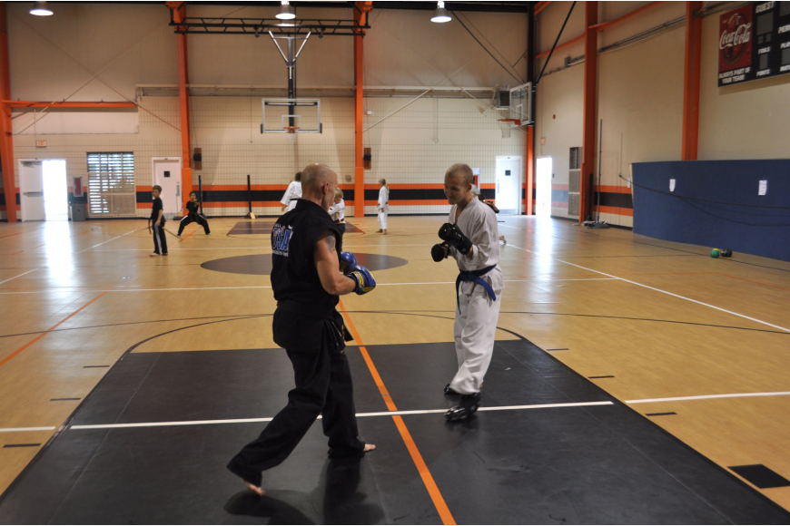 Michael Droeske and Ryan O'Hern practice their techniques by sparring.