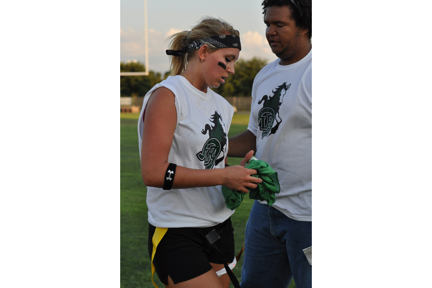 Quillan Toler consults with her coach, Shane Blair.