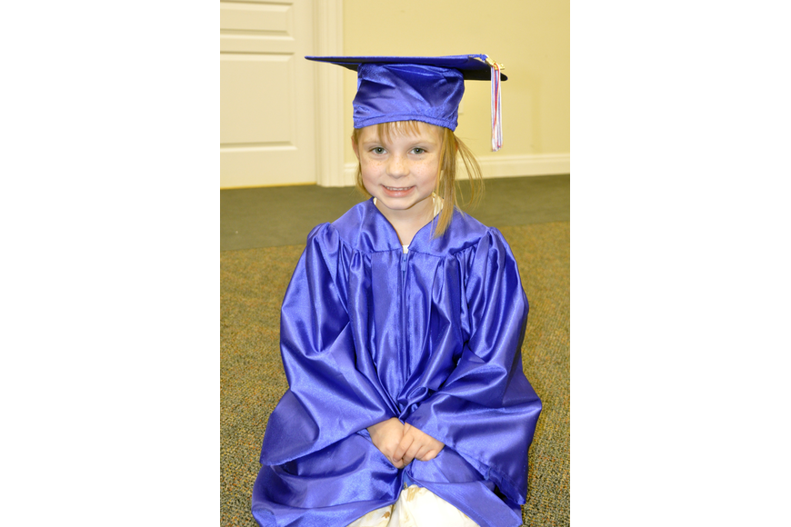 Five-year-old Juliana Anderson couldn't wait to receive her diploma.