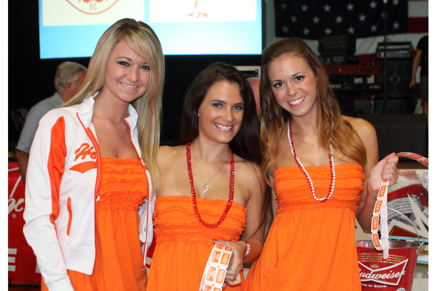 Avory Block, Amber Mominee and Elyse Zuber sold raffle tickets during the kickoff party, Saturday, June 23, at the Sarasota Municipal Auditorium.
