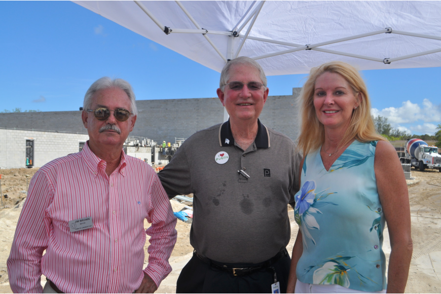 Mayor Jim Brown, Publix Vice Chairman Barney Barnett and Susan Phillips, assistant to the town manager