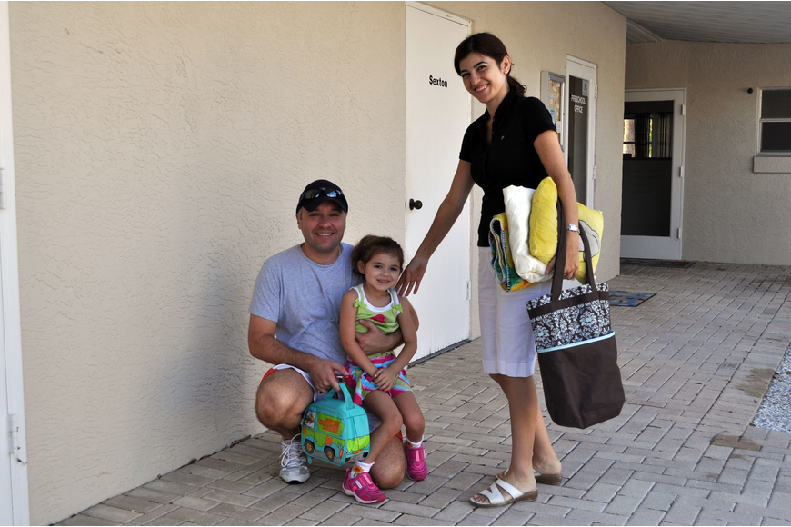Helene Giraud poses with her dad and mom, Claude and Nidale Giraud, prior to heading into her classroom, Monday, Aug. 20.
