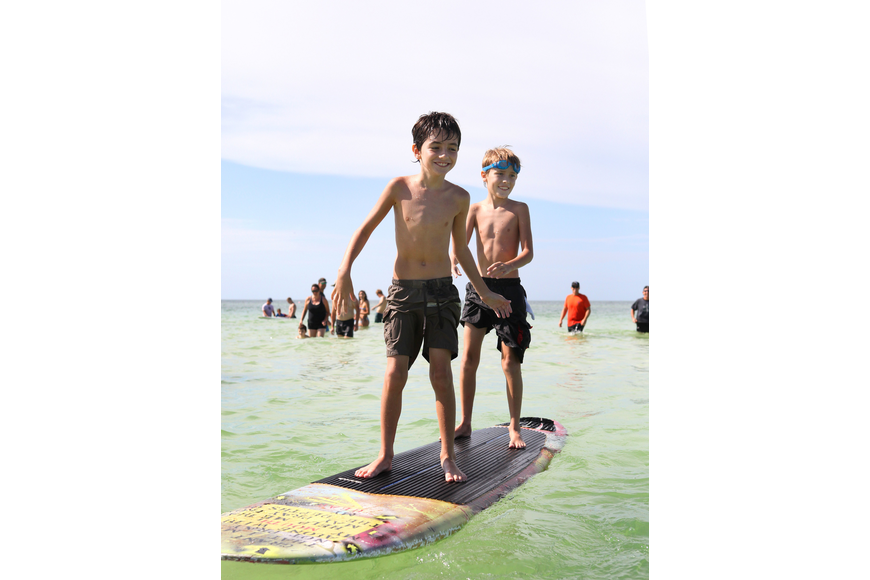 Dominick Baron, 8, and Julian Repetto, 8, have fun riding together.