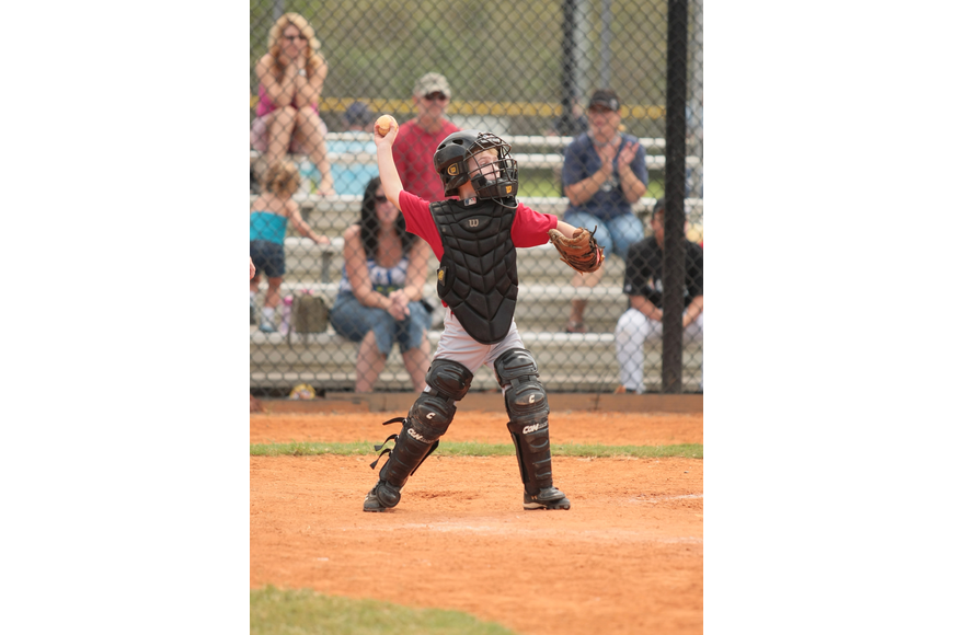 Connor McCray plays catcher for the Reds.
