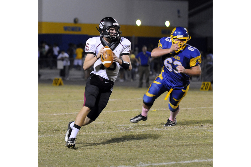 Braden River quarterback Dusty Peebles searches for an open receiver during the Pirates final drive of the game.