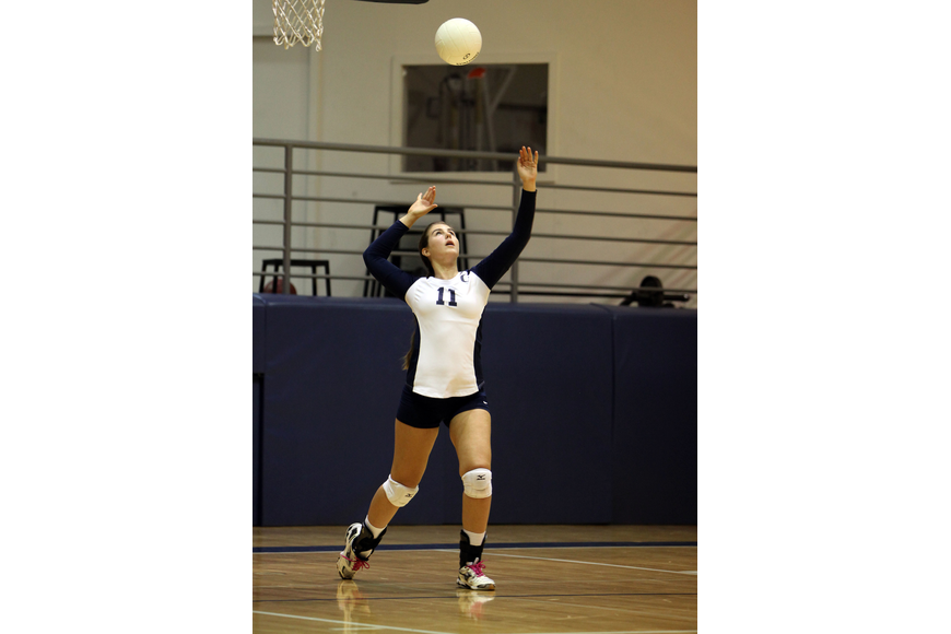 Monica Costa, No. 11, serves up the ball for the Out-of-Door Academy.