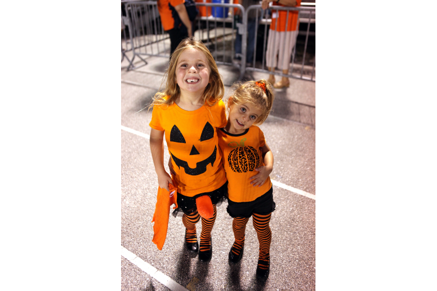 Bella, 5, and Carmella, 3, Frederick wore orange for Halloween and the Sarasota Sailors.