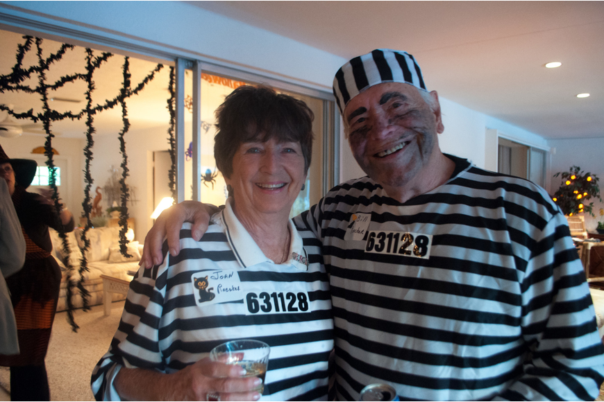 Joan and Bill Roecker dressed as prisoners.