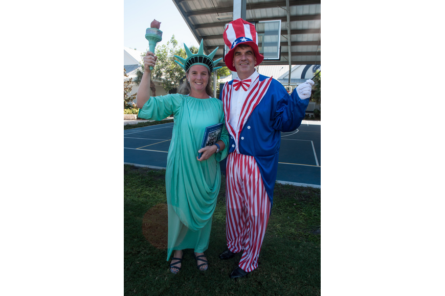 Head of School David Mahler lead the Halloween costume parade with his wife Elizabeth.