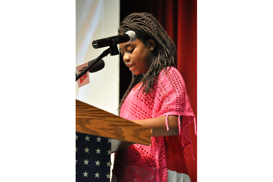 Aba Sankah, 10, was one of three student speakers at Freedom Elementary's ceremony.