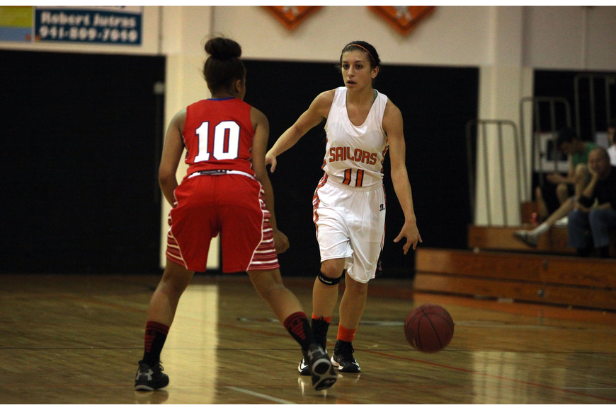 Sarasota's Kylie Warner, No. 11, dribbles the ball down the court while Manatee's Aja Nixon, No. 10, stays on her in hopes of stealing the ball.