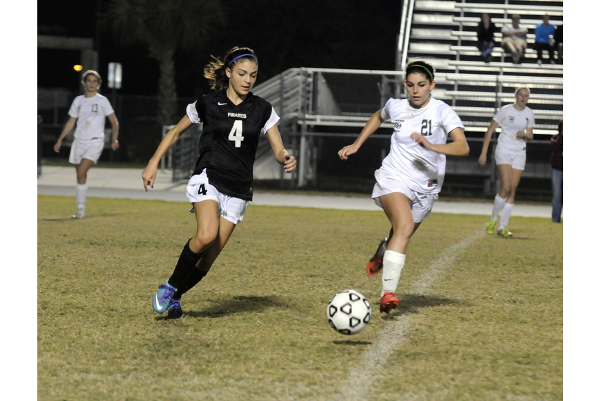 Braden River's Brittney Rangel and Lakewood Ranch's Angelica Rego race to the ball in the first half.
