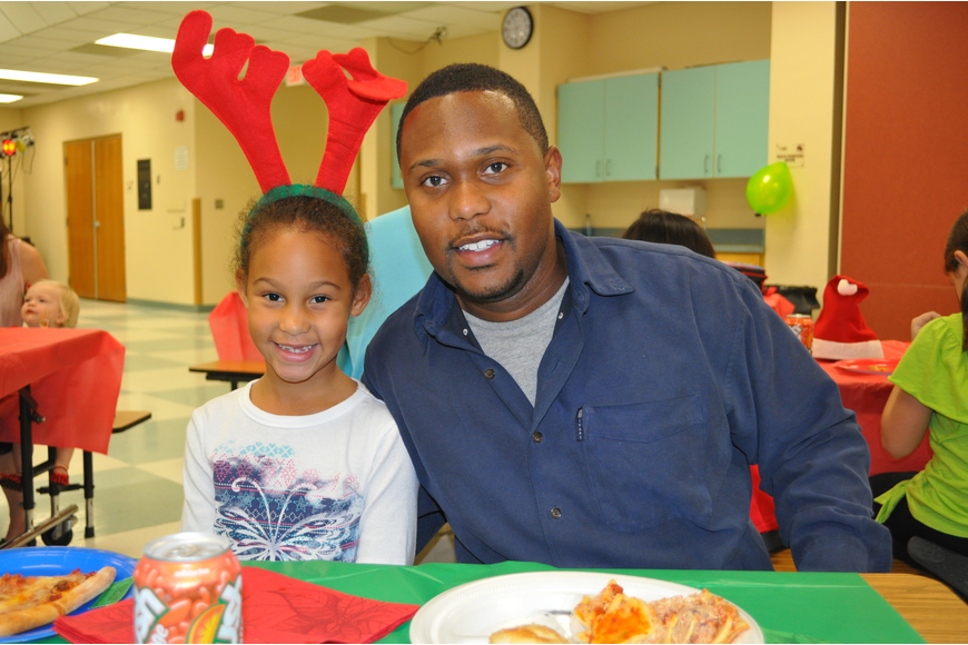 Melia Haddock, first grader at Tara Elementary, with her father, Jeremy